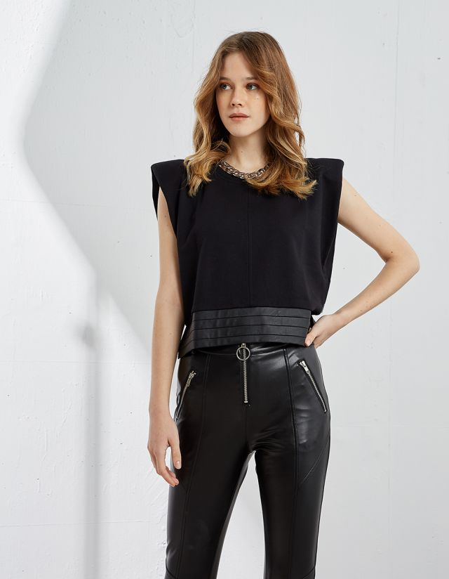 SLEEVELESS TOP WITH SHOULDER PADS