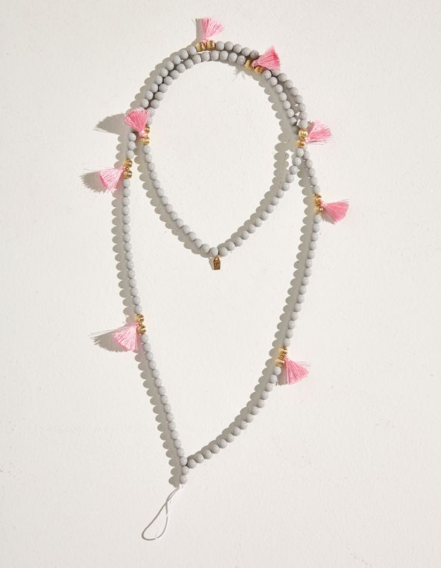 MOBILE ACCESSORY WITH BEADS