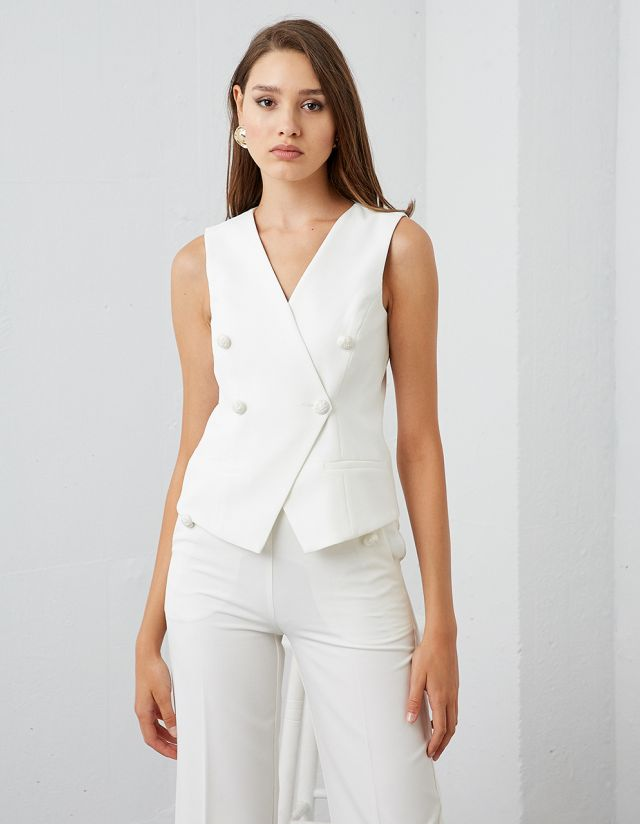 VEST WITH EMBOSSED BUTTONS