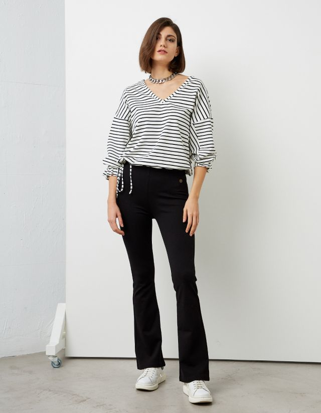 FLARED ELASTIC TROUSERS