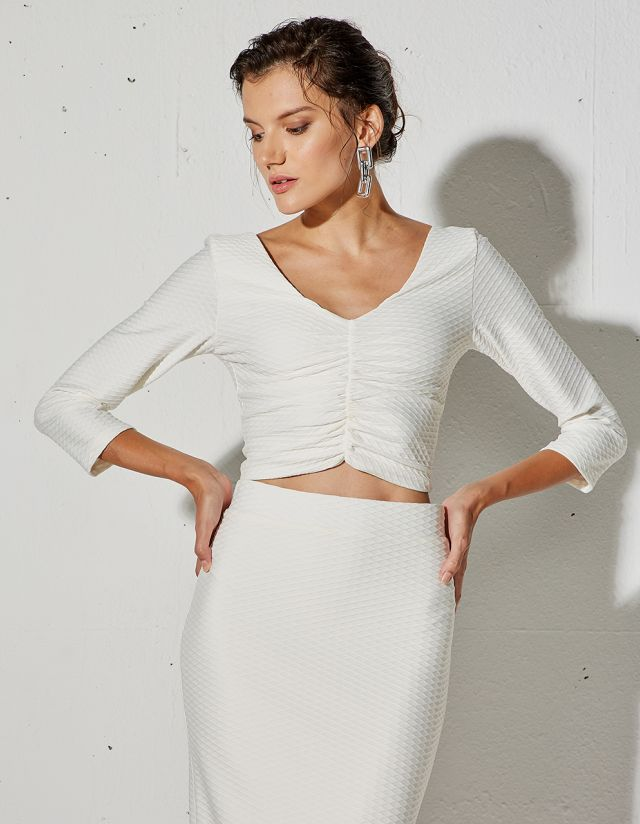 CROP TOP WITH EMBOSSED PATTERN